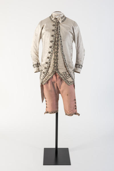 Man's cream silk satin embroidered coat and pink silk breeches, 1780s
